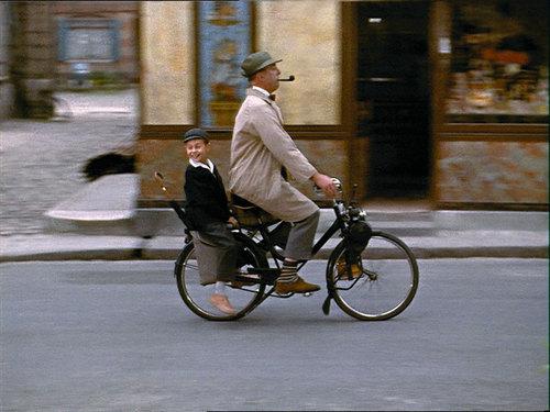 Jacques Tati andAlain Bécourt ride a bike